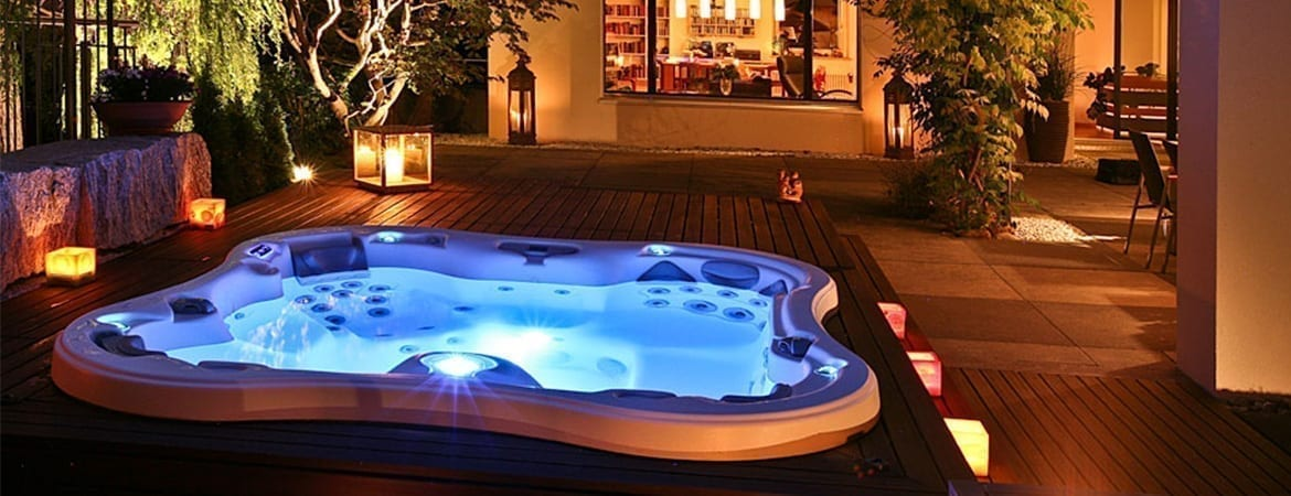 Lotus Bay Hot tub at night with blue lights on