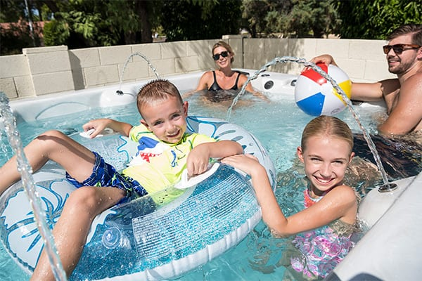 american whirlpool tub with happy family
